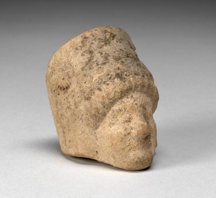 Head of a woman; fragment of terracotta figurine