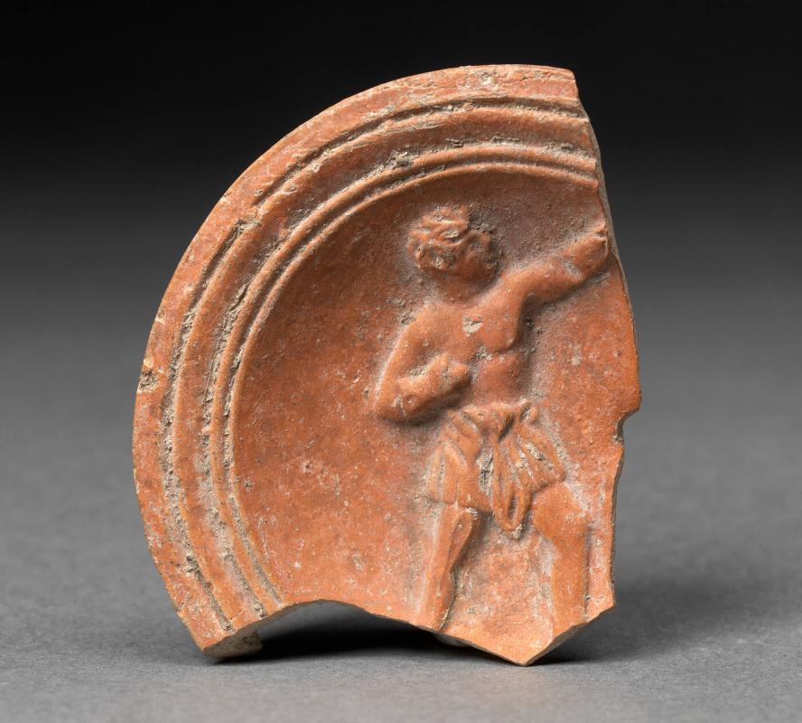 Fragment from an oil lamp with boxer motif