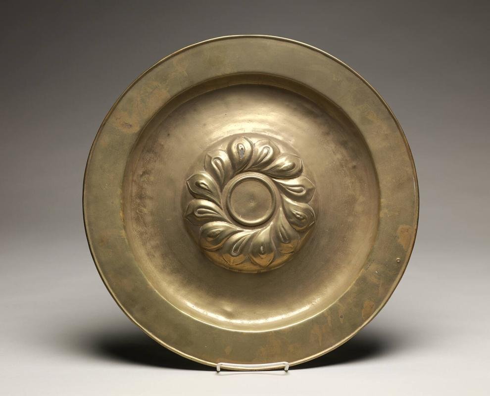 Dish with repoussé leaf design