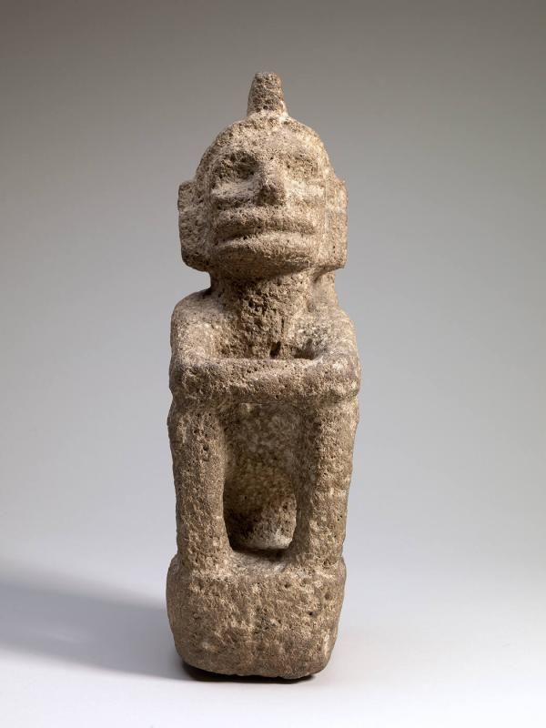 Seated deity with crested headdress
