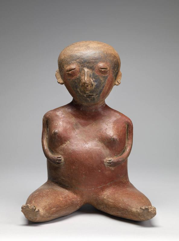 Seated pregnant woman