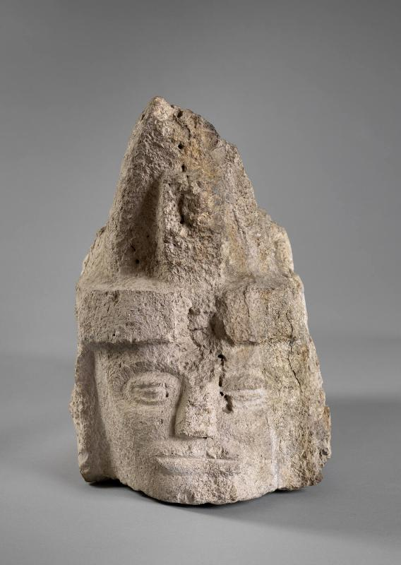 Corbel with human head wearing a peaked headdress
