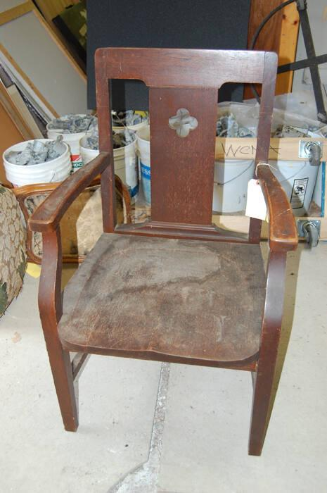 Arm chair with quatrefoil design