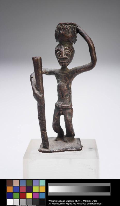 Goldweight showing a standing man with stick