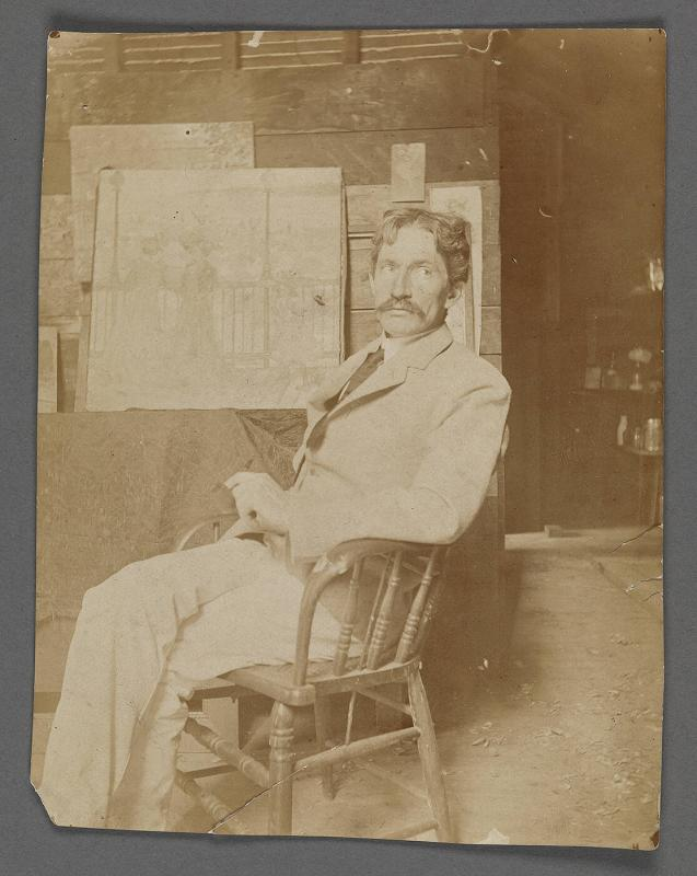 Charles Prendergast  seated in his studio