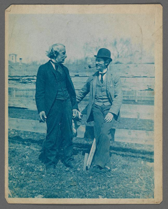 Maurice Prendergast, Sr. and Charles Prendergast standing in front of fence