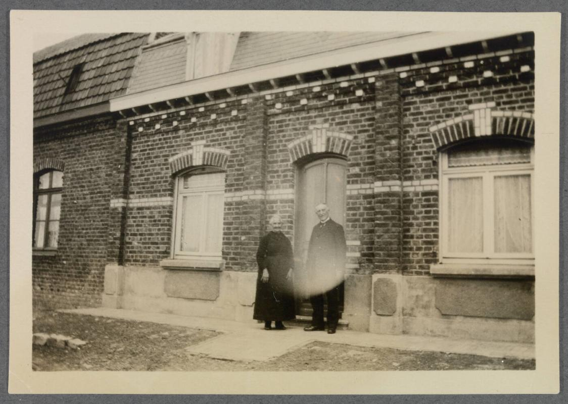 1927-1929 series of Eugénie and Charles Prendergast and Vankemmel family members in France; couple standing in front of building