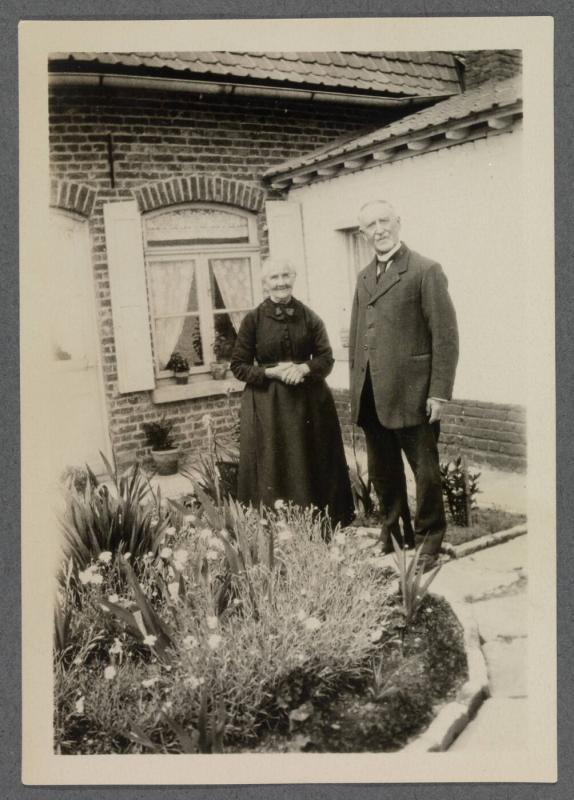 1927-1929 series of Eugénie and Charles Prendergast and Vankemmel family members in France; couple standing in garden