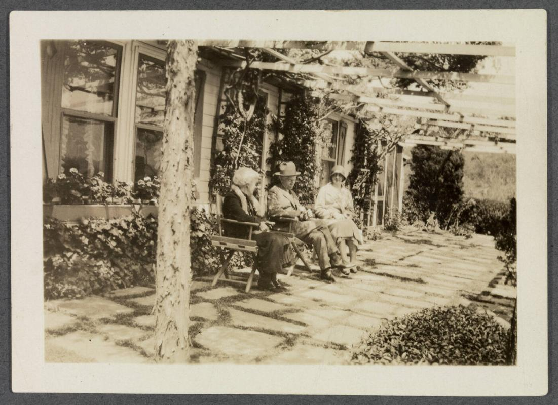 1927-1929 series of Eugénie and Charles Prendergast and Vankemmel family members in France; Eugénie and Charles Prendergast, and woman seated in front of house