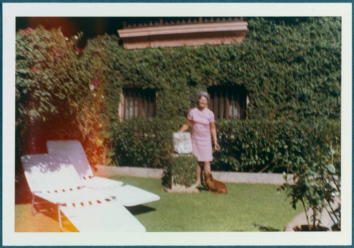 Cuernavaca, Mexico home of Robert Brady; Woman with dog in yard