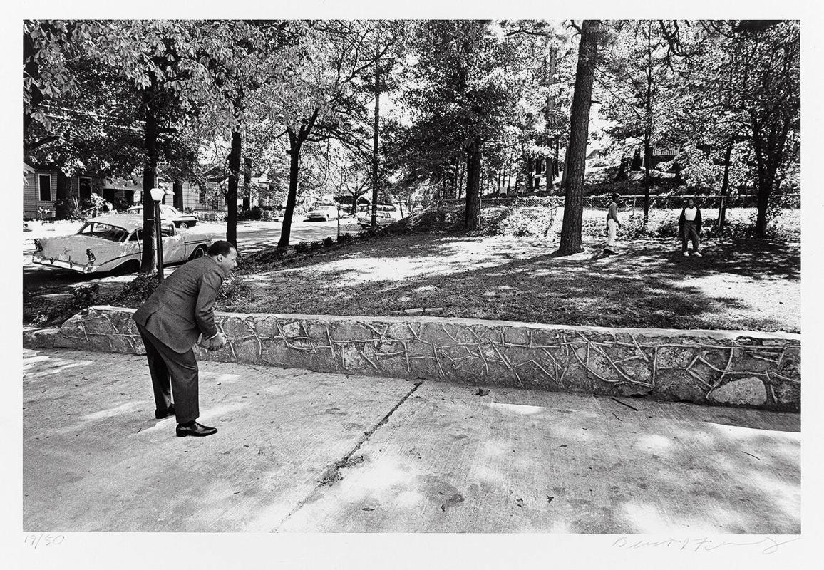 "In the front yard of his Atlanta home, Dr. Martin Luther King, Jr. takes time for a game of catch with his sons (from ""Countdown to Eternity"")"