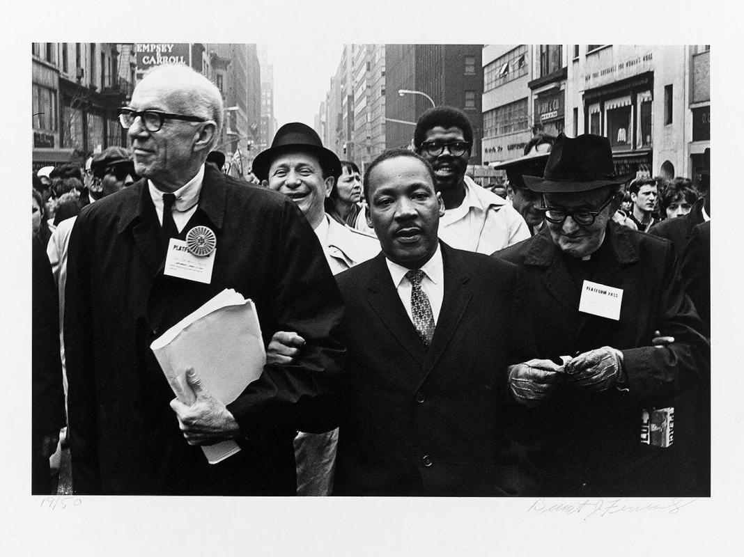 "Dr. Benjamin Spock, Dr. Martin Luther King, Jr. and Monsignor Rice of Pittsburgh march in the Solidarity Day Parade at the United Nations Building, April 15, 1967 (from ""Countdown to Eternity"")"