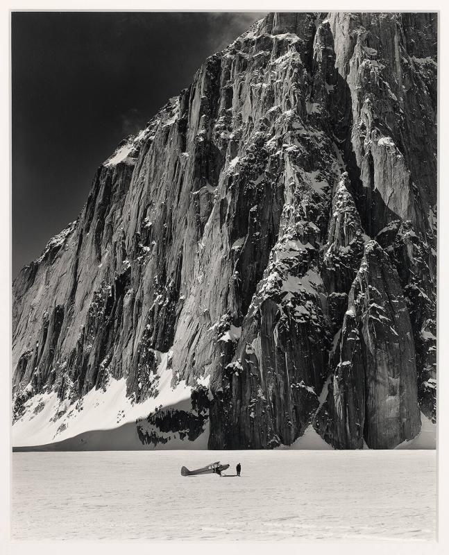Don Sheldon with his Super Cab Plane in the Great Gorge of the Ruth Glacier at the foot of Mt. Dickey, Alaska, 1955