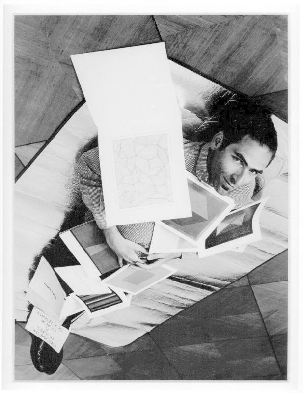 The artist covered in a selection of his Sol LeWitt books (cut) (after Ed Ruscha) Down