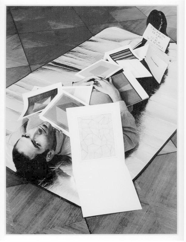 The artist covered in a selection of his Sol LeWitt books (cut) (after Ed Ruscha) Up