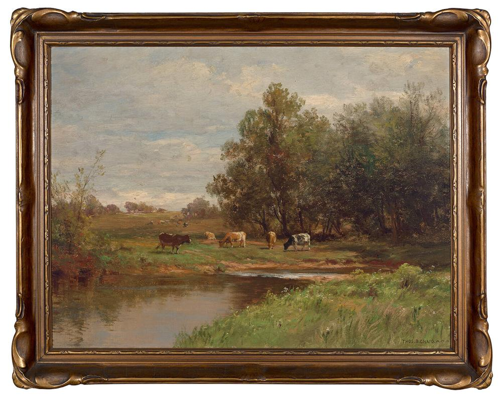 Cows grazing near a river