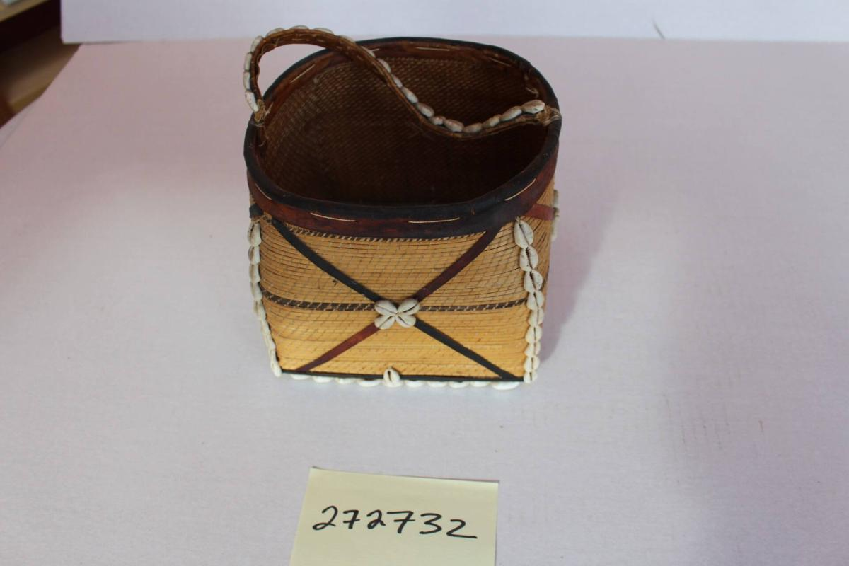 Basket with handle and cowries