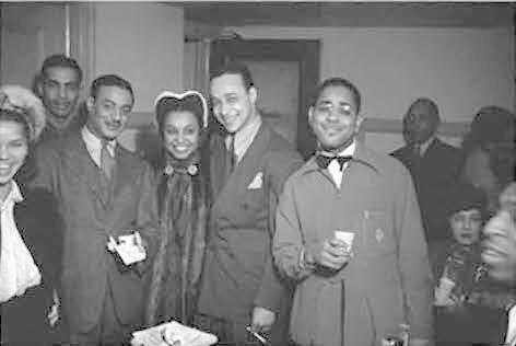 "Charles ""Cholly"" Atkins, Donald Mills, Avis Andrews, Louis Brown, Dizzy Gillespie, and Keg Johnson, backstage, Earle Theater, Philadelphia"