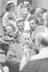 Drummers: Front row: George Wettling and Bud Freeman; Second row: Jo Jones, Gene Krupa, Sonny Greer; Third row: Miff Mole, Zutty Singleton, Red Allen; Fourth row: Dickie Wells, Art Blakey, and Taft Jordan; Top row: Buck Clayton, Benny Golson, Art Farmer and Hilton Jefferson, Esquire Magazine photo shoot, Harlem, New York City