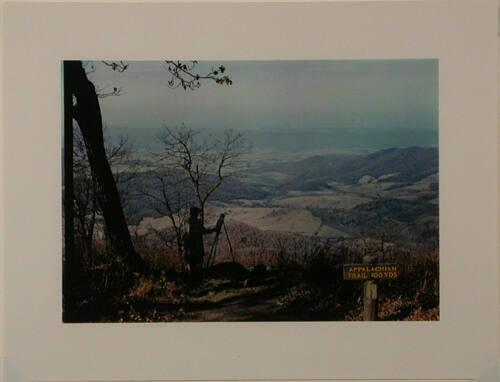 A man painting a view of the Shenandoah Valley from the Skyline Drive, near an entrance to the Appalachian Trail. Virginia