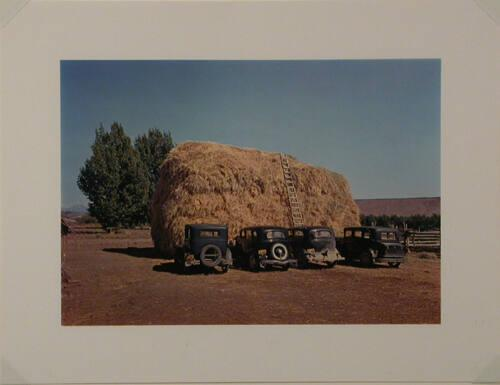 Haystack and automobile of peach pickers, Delta County, CO