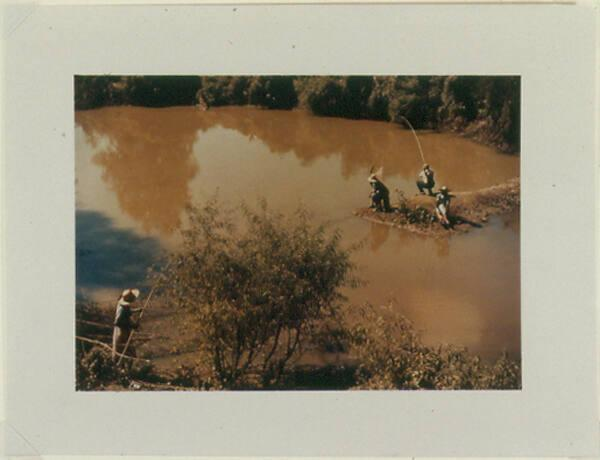 Negroes fishing in creek near cotton plantations outside Belzoni, Miss.