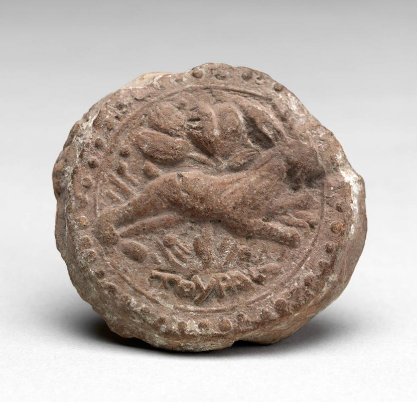 Disk with running tiger relief